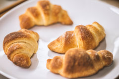 Tasty croissants with spikelets Royalty Free Stock Photography
