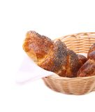 Tasty croissants on wicker basket. Royalty Free Stock Photo