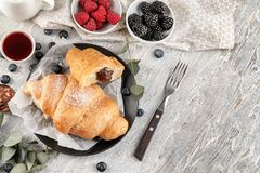 Free Tasty Croissants With Jam And Berries On Light Table Royalty Free Stock Images - 151196569
