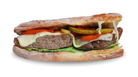 Tasty crunchy cheeseburger sandwich with beef, melt cheese, tomatoes, cucumber and salad stock images