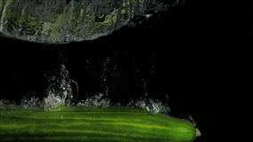 Tasty cucumber in super slow motion falling in the water stock video