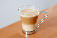 Tasty cup of coffee with milk Stock Photo