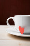 Tasty cup of tea made with love. Hot drink is prepared with love stands on a table Stock Images