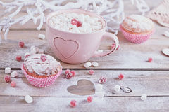 Tasty cupcake with berries and cup of coffee Stock Images