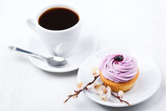 Tasty cupcake with cup of coffe isolated. On white background Royalty Free Stock Image