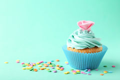 Tasty cupcake on a green background Stock Photo
