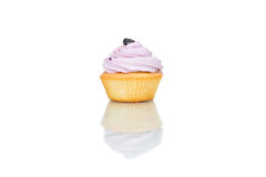 Tasty cupcake, isolated on white. Rose Royalty Free Stock Image