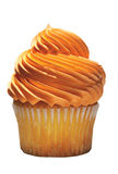 Tasty cupcake with orange icing Stock Image