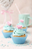 Tasty cupcake on the pink background Royalty Free Stock Images
