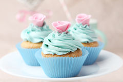 Tasty cupcake on the pink background Royalty Free Stock Image