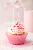 Tasty cupcake on the pink background Stock Images