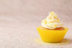 Tasty cupcake. On pink background Stock Photo