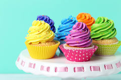 Tasty cupcakes. On cake stand on green background royalty free stock photos