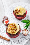 Tasty cupcakes with candies and chocolate on light background close up Royalty Free Stock Photography