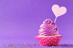 Tasty cupcakes. On a purple background Stock Photography