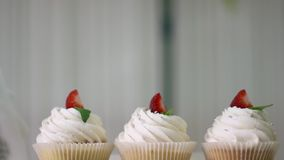 Tasty cupcakes on stand stock footage