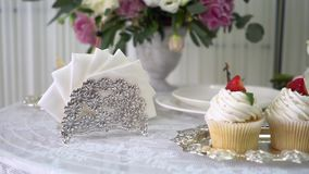Tasty cupcakes on stand. Beautifully laid table for breakfast. stock video