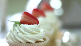 Tasty cupcakes on stand stock video footage