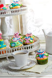 Tasty cupcakes with sweet decoration and coffee Royalty Free Stock Photo