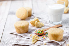 Tasty cupcakes on a white wooden table. Vanilla cupcakes on a checkered cloth Horizontal Royalty Free Stock Photo