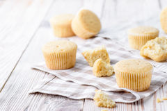 Tasty cupcakes on a white wooden table. Vanilla cupcakes on a checkered cloth Horizontal Stock Images