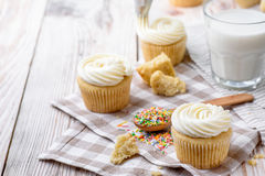 Tasty cupcakes on a white wooden table. Vanilla cupcakes on a checkered napkin Horizontal Royalty Free Stock Images