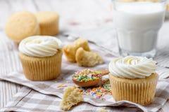 Tasty cupcakes on a white wooden table. Vanilla cupcakes on a checkered napkin Horizontal Royalty Free Stock Photography