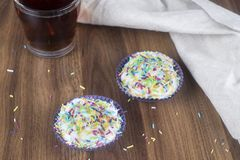 Tasty cupcakes on a wooden table royalty free stock image