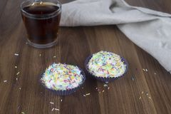 Tasty cupcakes on a wooden table stock photography