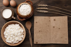 Tasty curd in pot on wooden background. Homemade, cottage cheese Royalty Free Stock Photo