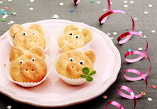 Tasty cute pig cookies with leaves on pink plate stock photography