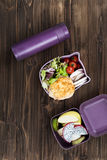 Tasty cutlet lying on salad leaves in lunch box Stock Photos
