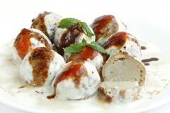 Tasty Dahi vada with topping of red sauce Royalty Free Stock Photos