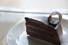 tasty dark chocolate cake on white plate. sliced delicious cocoa Royalty Free Stock Photography