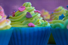Tasty decorate muffins Royalty Free Stock Photos
