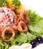 Tasty deep fried squid rings Stock Photo