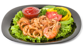 Tasty deep fried squid rings and fried prawn Royalty Free Stock Image