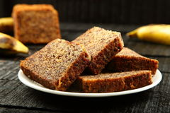Tasty Delicious banana cake slices. Homemade banana cake slices. on a wooden table stock photography