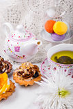 Tasty and delicious cake with  cup of green tea on  white tablecloth Stock Images