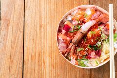 Tasty and delicious chirashi japanese food on wooden table background, Healthy Eating and Eat Well Concept. Take away home food.
