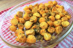 Tasty and delicious food ready for the lunch, sweet potatoes yams baked in the oven with the spices and herbs royalty free stock images