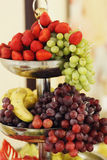 Tasty and delicious healthy fruit table grapes, apples and red s Royalty Free Stock Photography