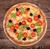 Tasty delicious pizza on the old boards Stock Image