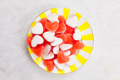Tasty delicious red mermaids in form of heart on beautiful plate. Tasty delicious red mermaids in the form of heart on a beautiful plate Royalty Free Stock Images