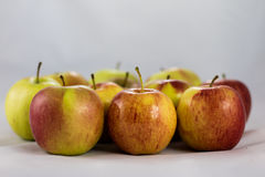 Tasty, delicious ripe apples on a white background Royalty Free Stock Photos