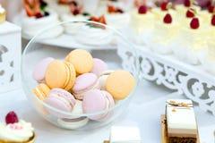 Tasty desert sweet macarons on wedding, close up