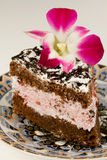 Tasty dessert with flower orchid Stock Images