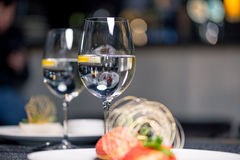Tasty dessert with glasses of water on table in restaurant Stock Photo