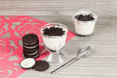Tasty dessert of milk made with black cookies.  royalty free stock photos