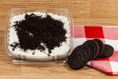 Tasty dessert of milk made with black cookies.  stock photography